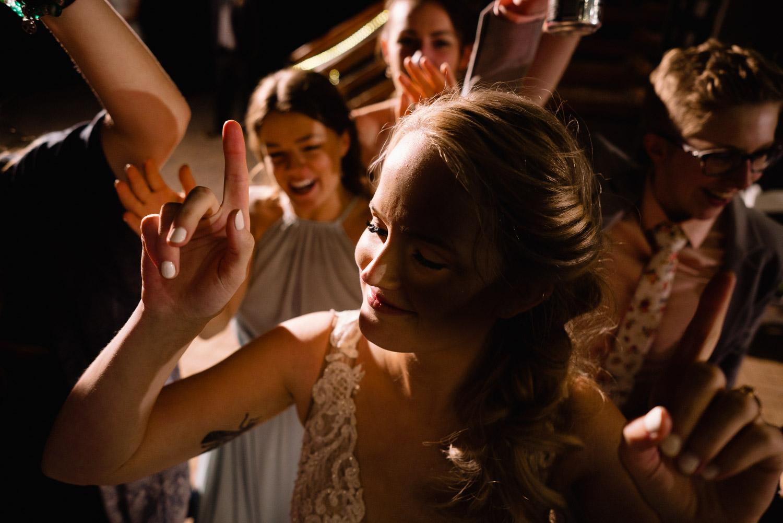 bride dancing with friends at reception alta wedding