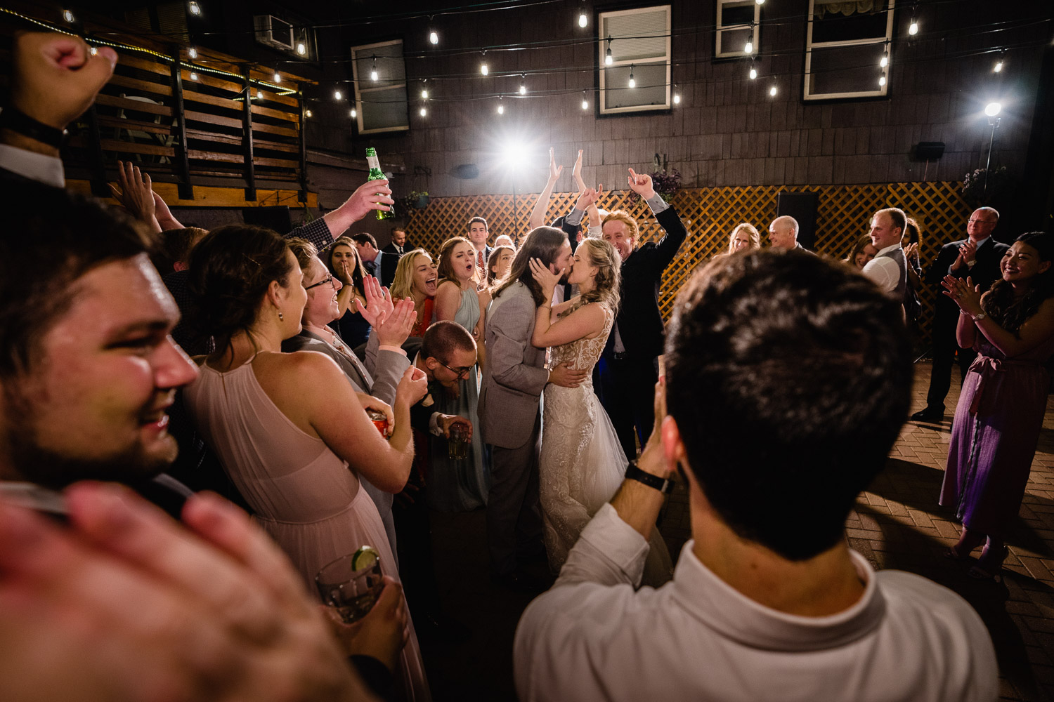 bride and groom kissing and guests cheering alta lodge