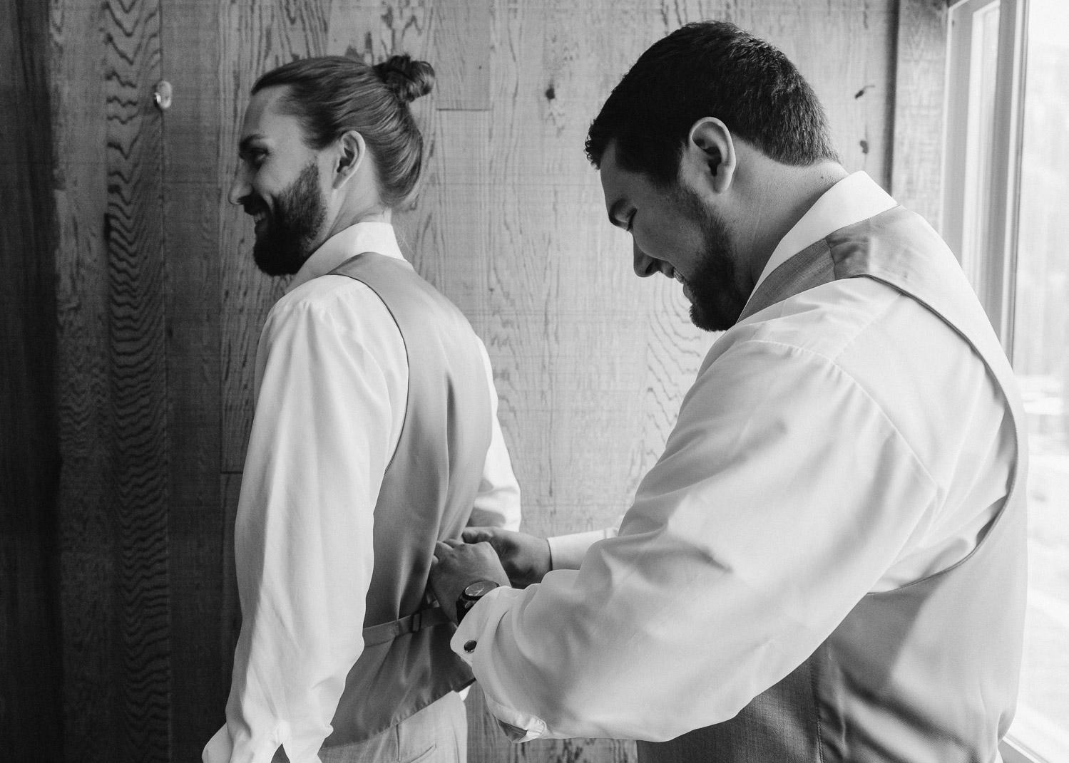 best man tightening grooms vest alta lodge