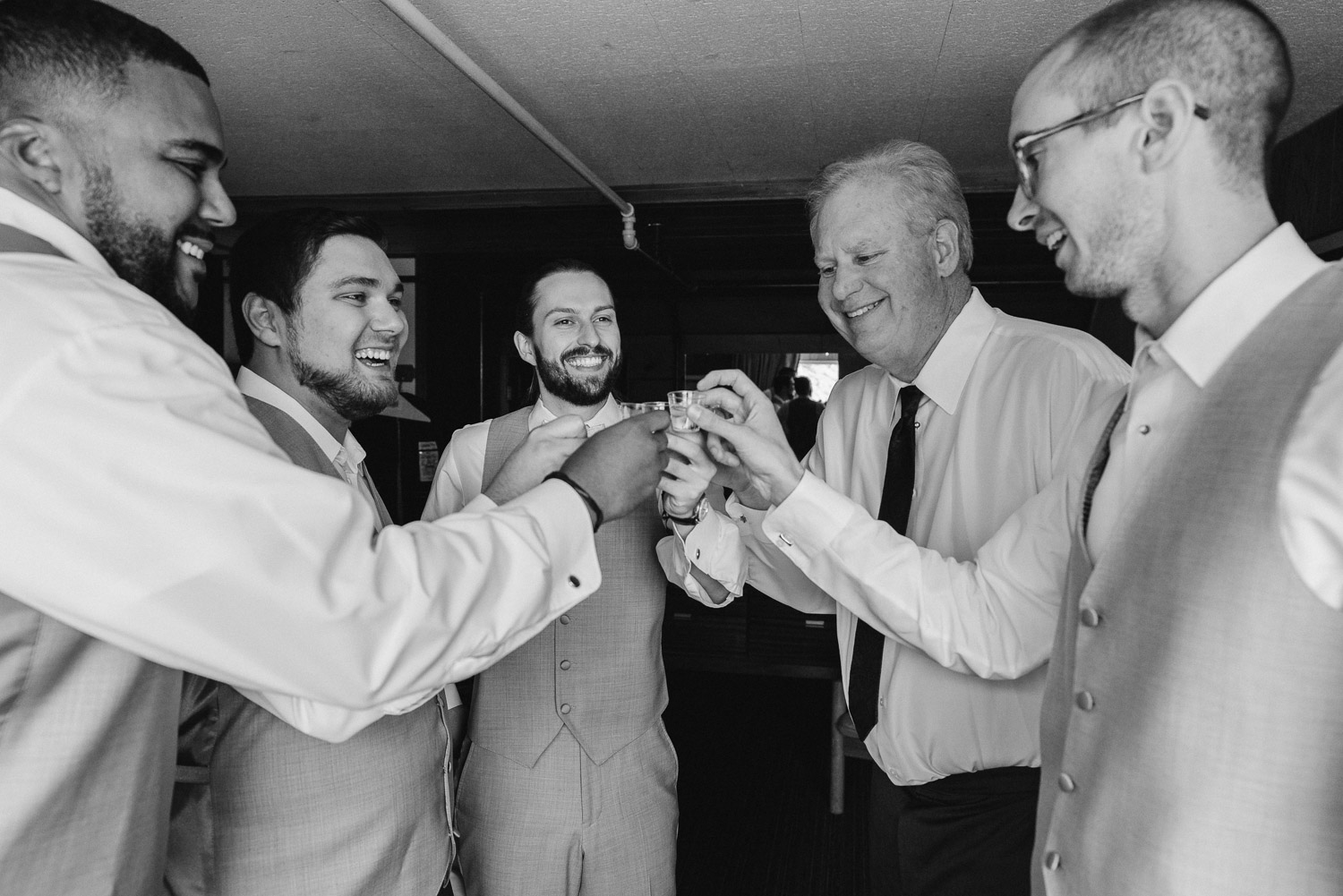 grooms men cheers a shot before the wedding alta lodge