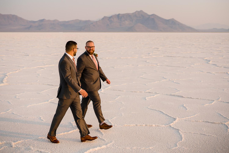 grooms walking and talking salt flats wedding