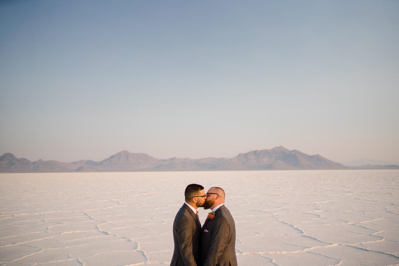 grooms kissing elopement salt flats