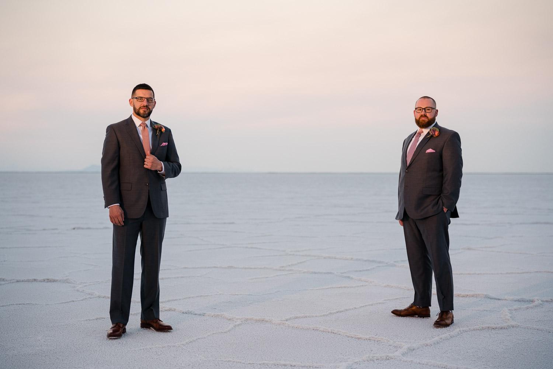 men looking forward in suits salt flats