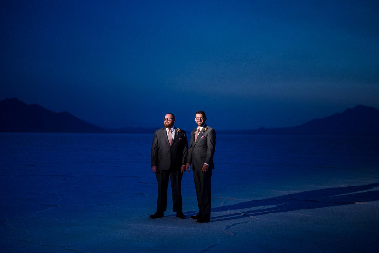 grooms in blue light salt flats wedding