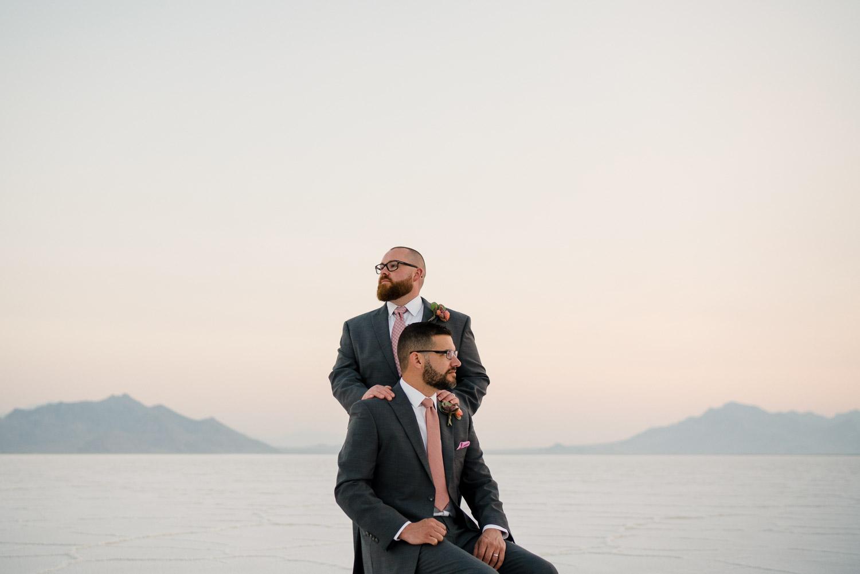 men's hands on shoulders salt flats wedding