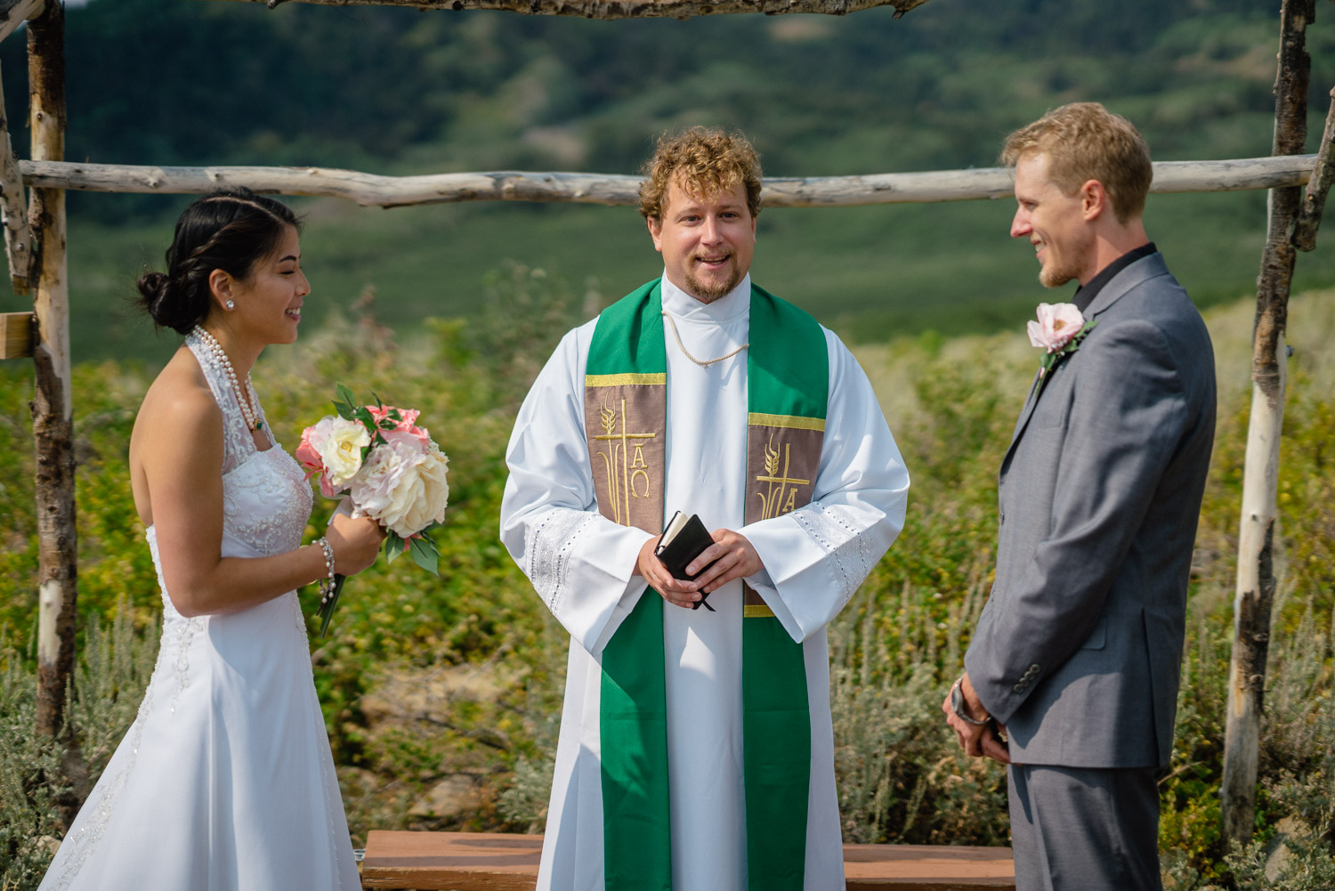 bride groom and officiant outdoor altar utah