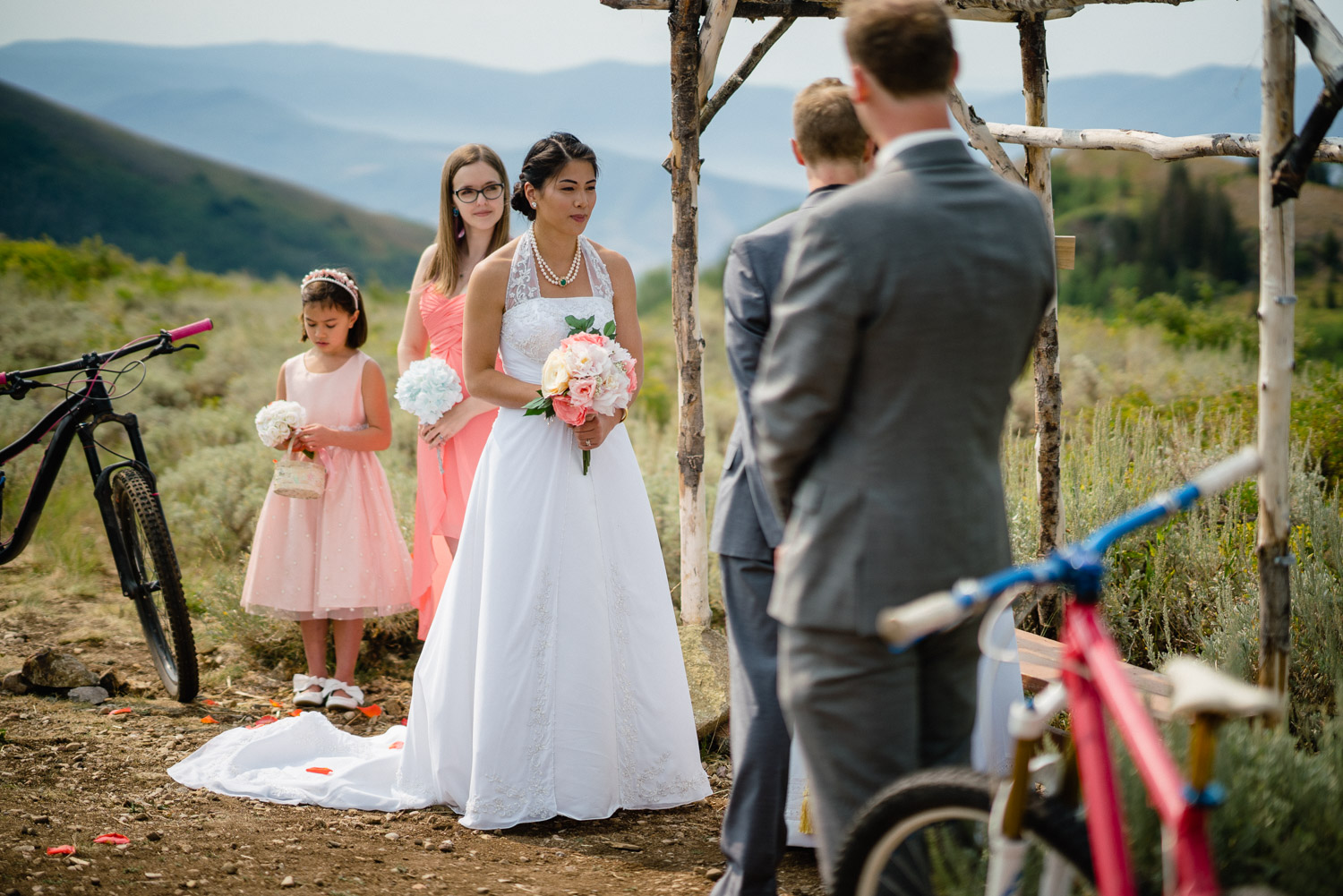 bridal party at outdoor altar during wedding ceremony