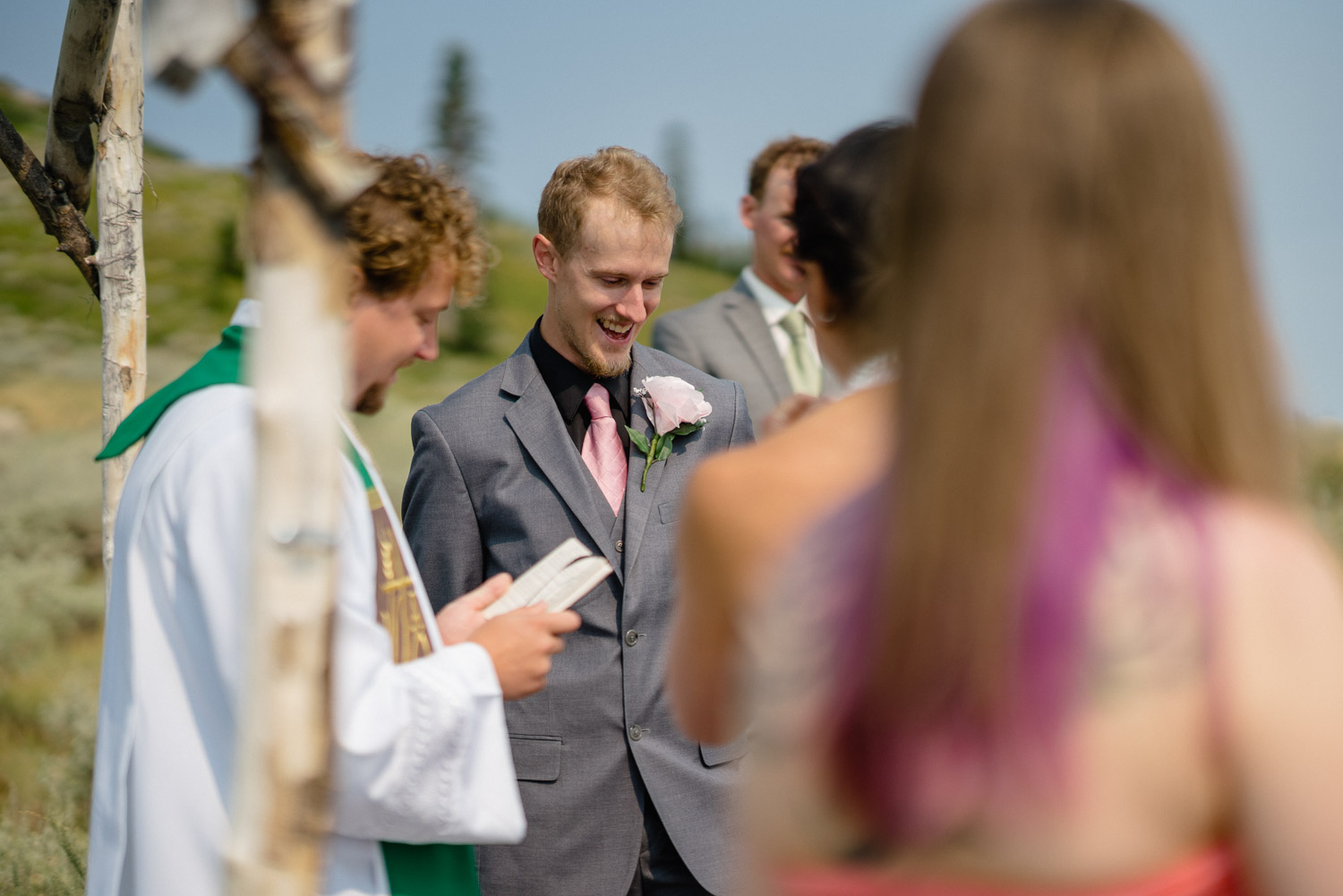 focus on groom by outdoor altar