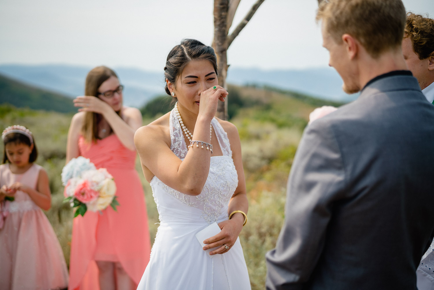 bride crying during outdoor wedding ceremony