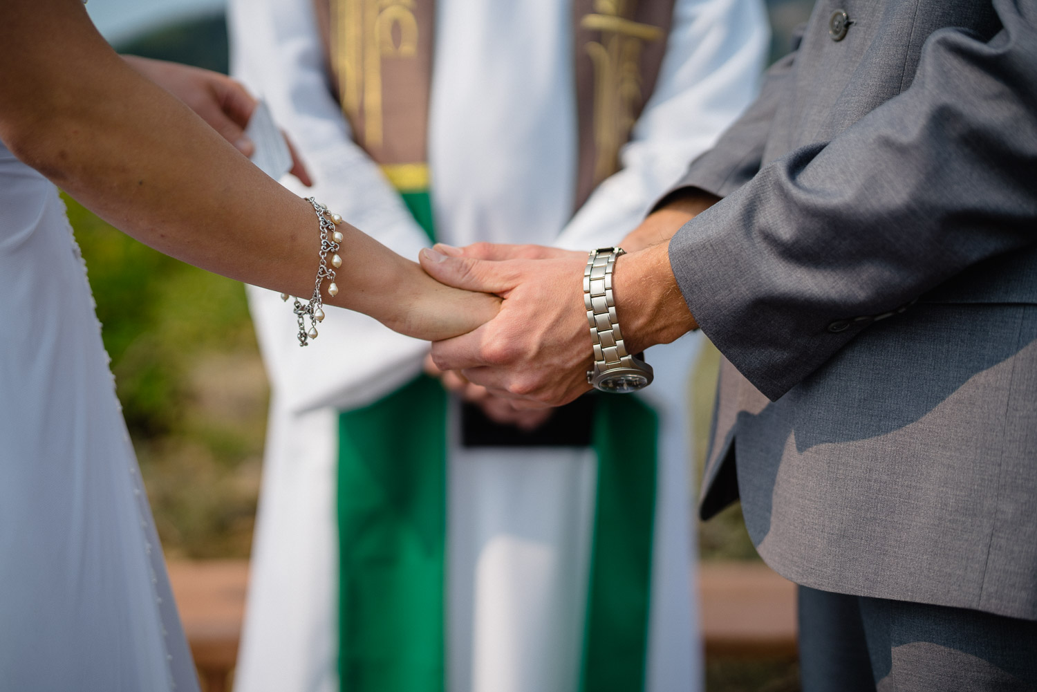 bride and groom holding hands at outdoor altar utah wedding