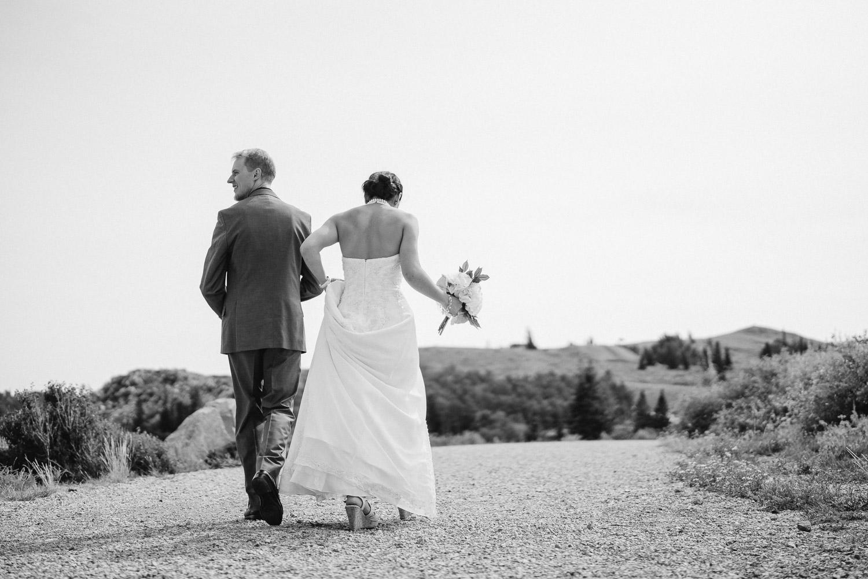 bride and groom walking down dirt path utah outdoor wedding