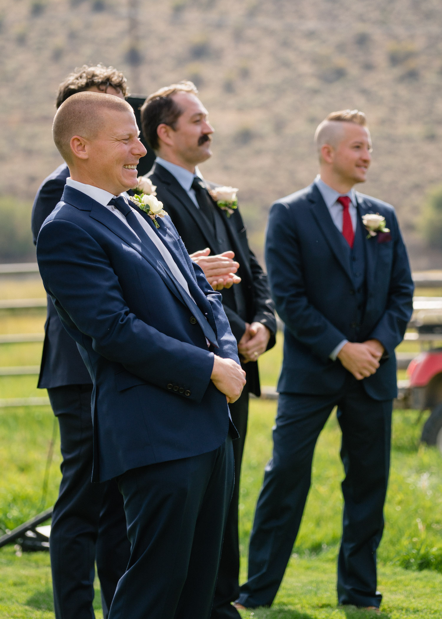 groom and groomsmen excited outdoor wedding