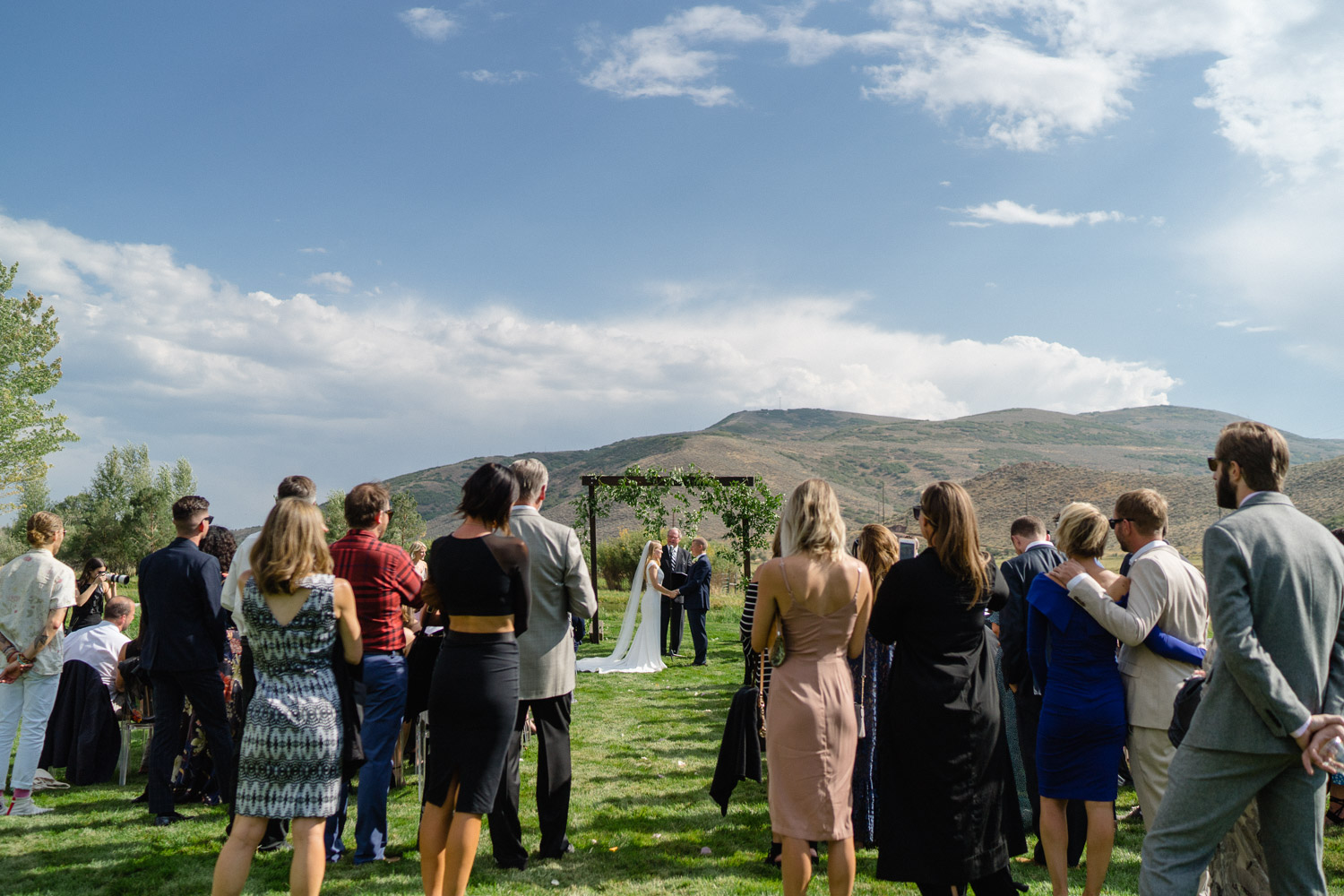 couple at outdoor altar and wedding guests park city