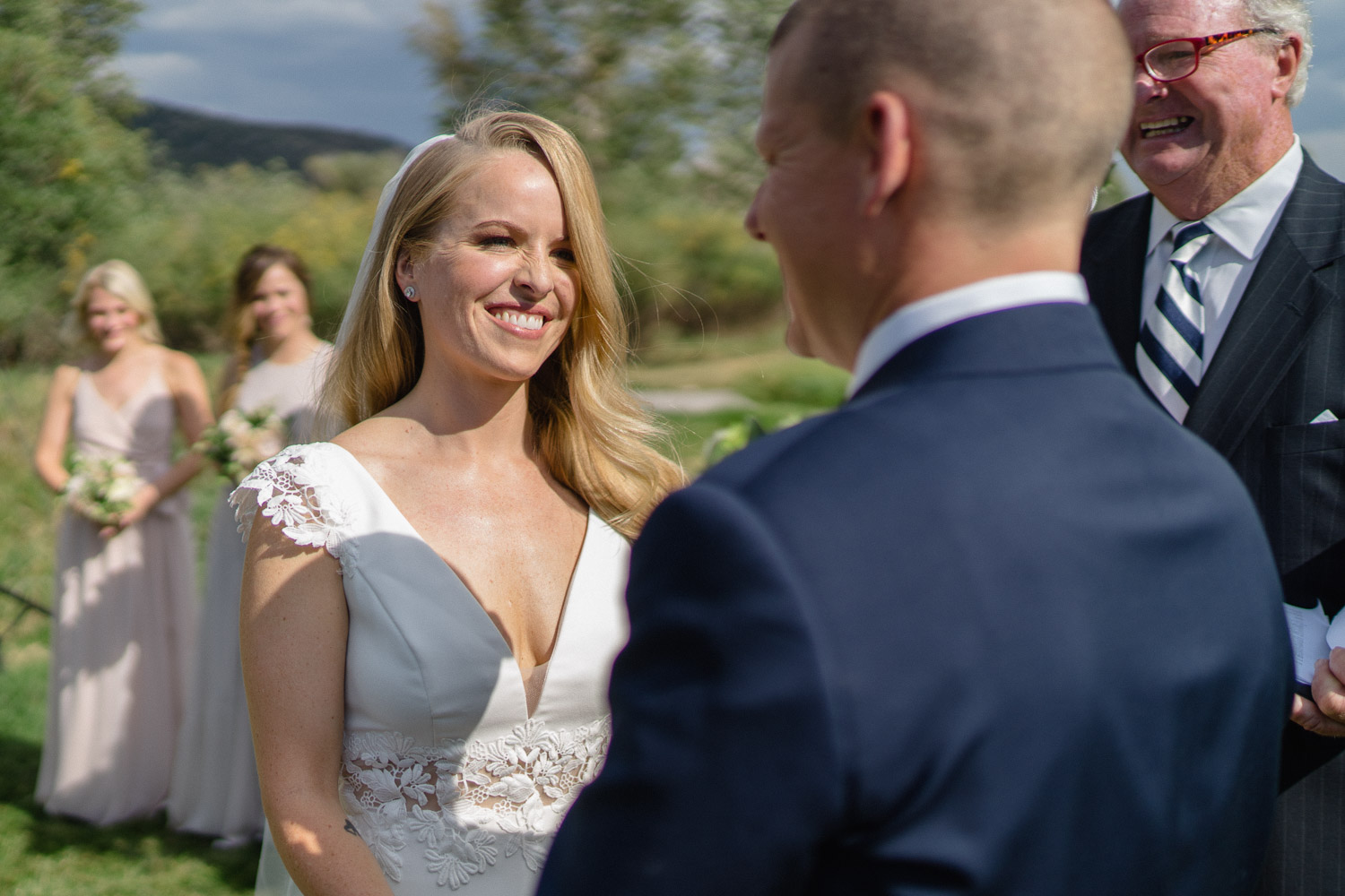 bride smiling at groom at outdoor altar park city wedding