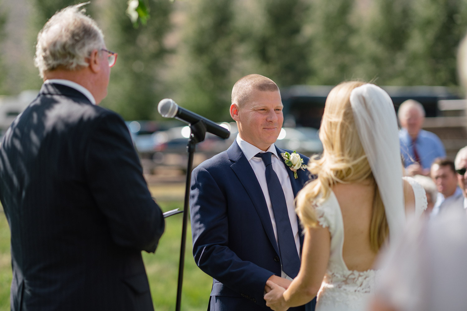 groom smiling at bride outdoor wedding park city