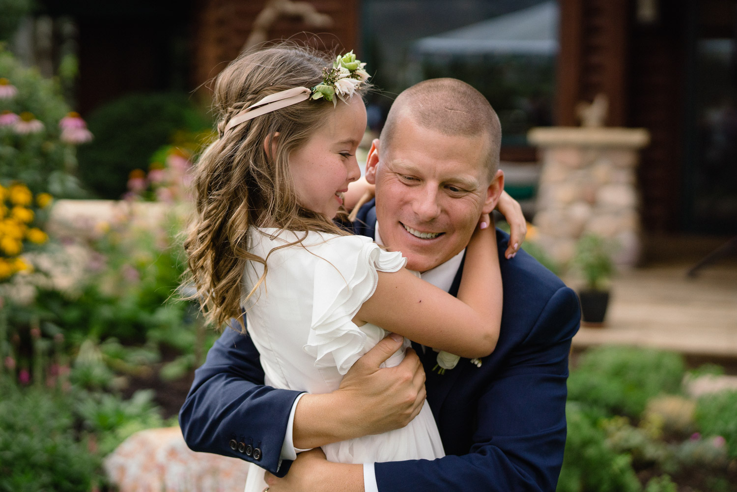 groom hugging girl outside in yard park city wedding