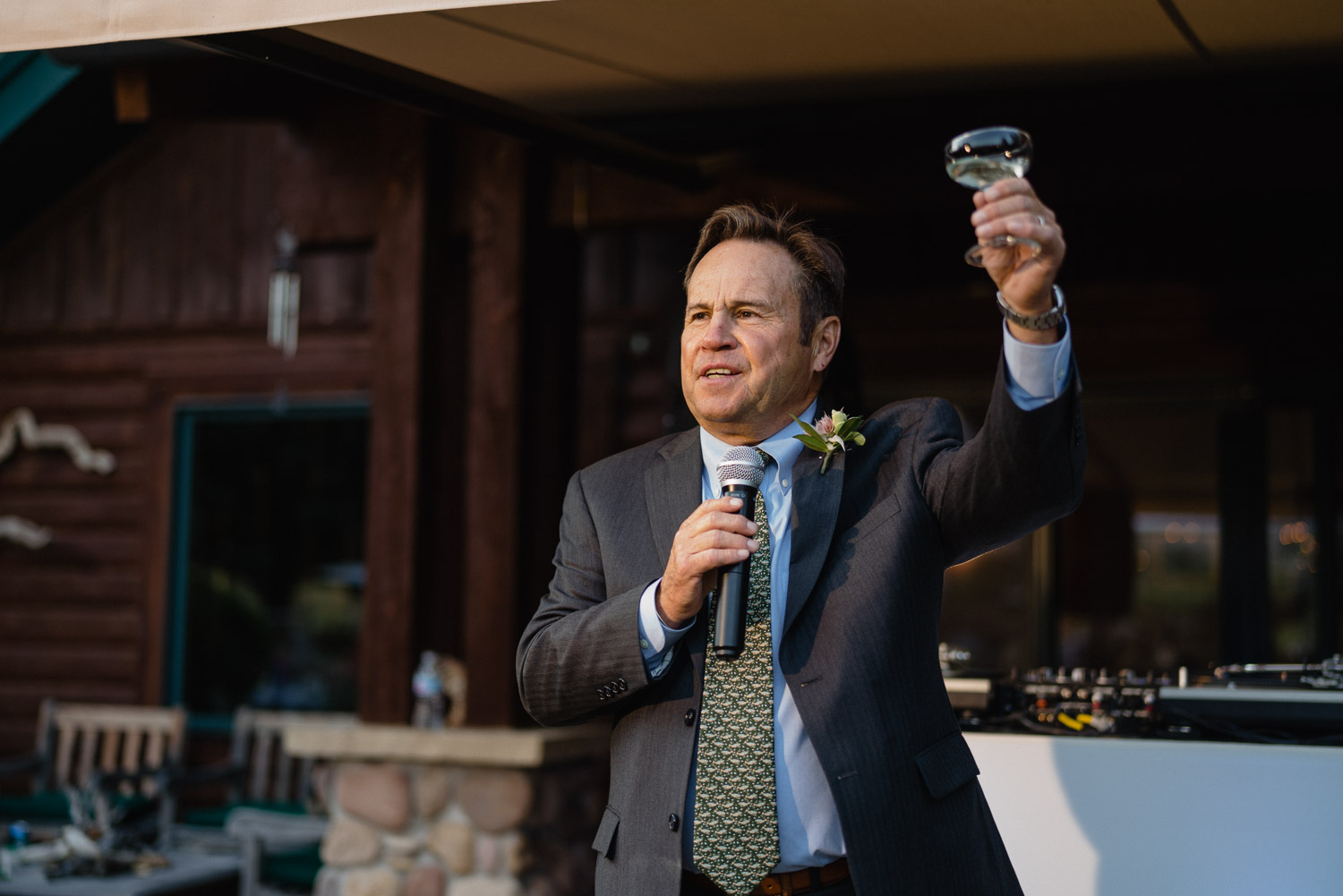 father giving toast outside park city wedding