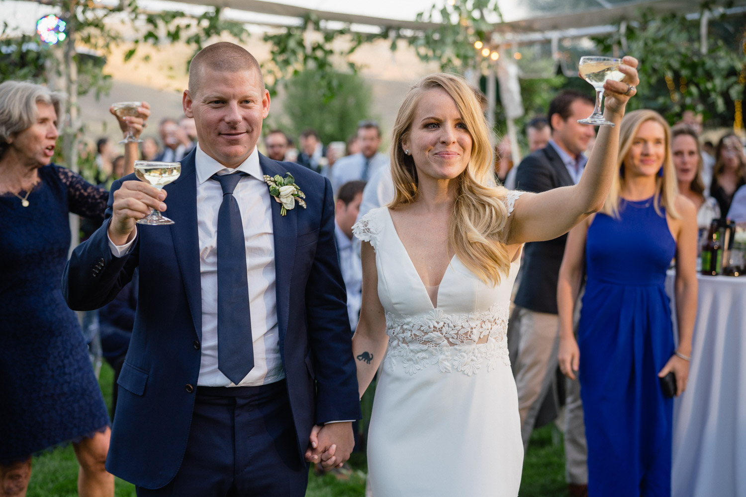 bride and groom raise glasses for toast park city wedding