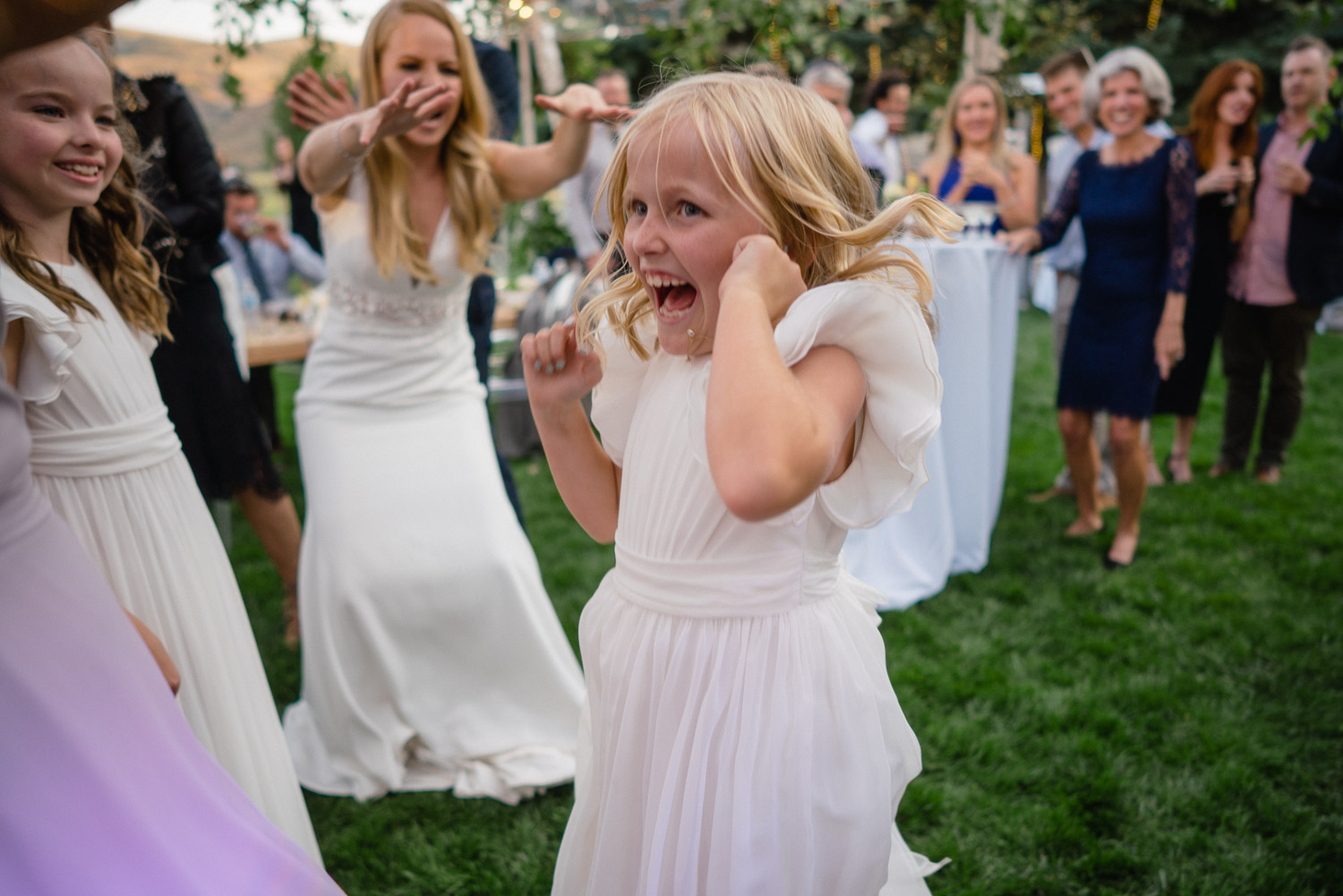 bride dancing with girls outside park city wedding celebration
