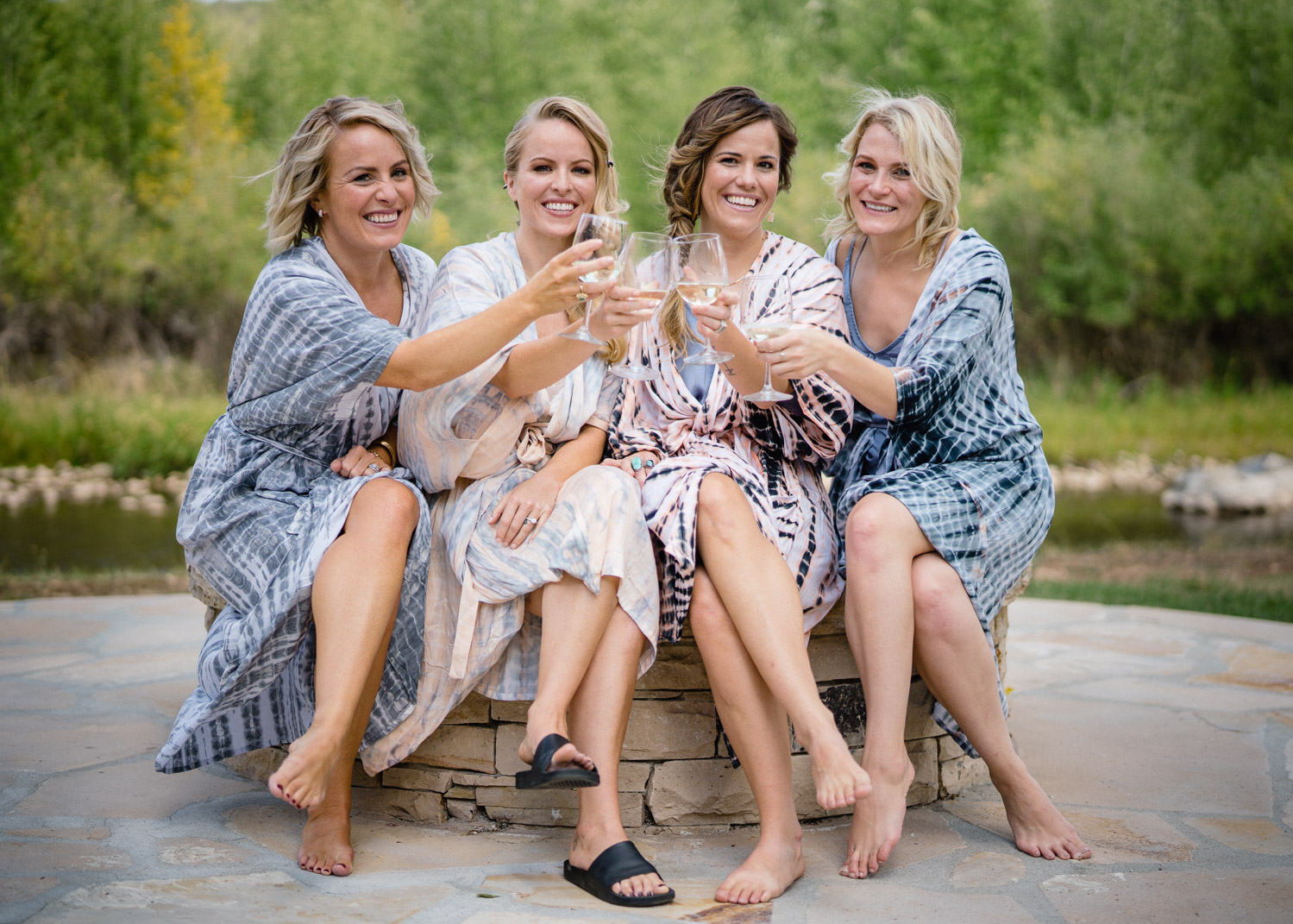 bridal party in robes with champagne park city wedding