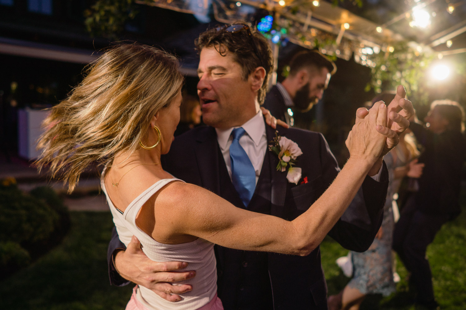 couple dancing at night under lights park city outdoor wedding