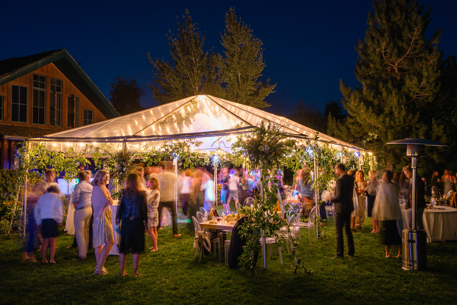 night sky outdoor wedding party under tent park city
