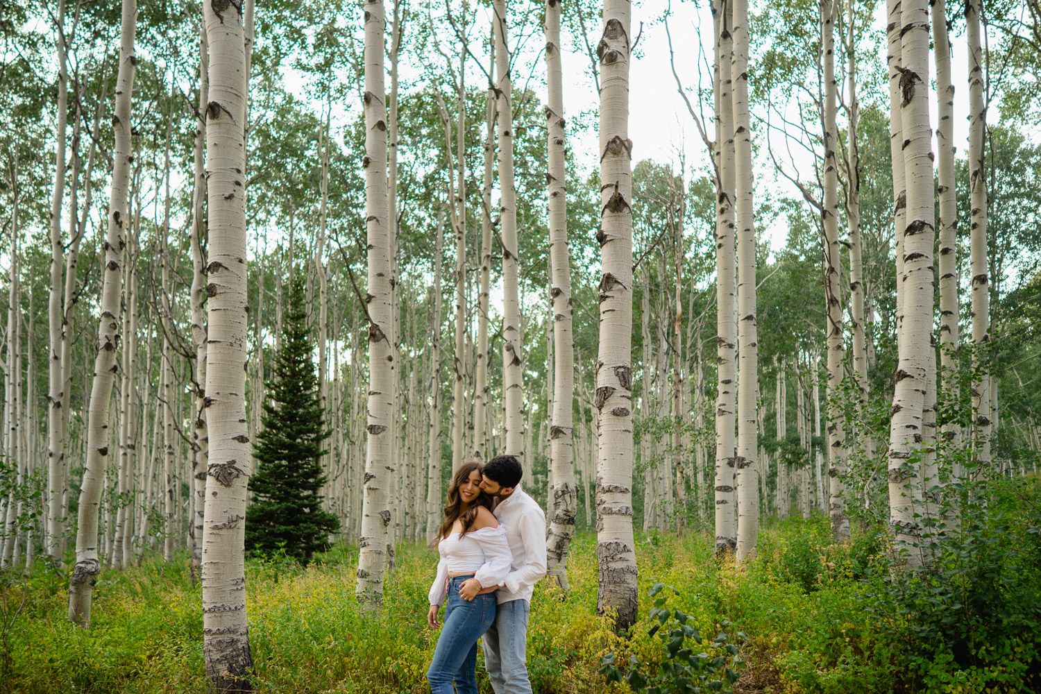 man and woman engagements trees blue sky empire pass
