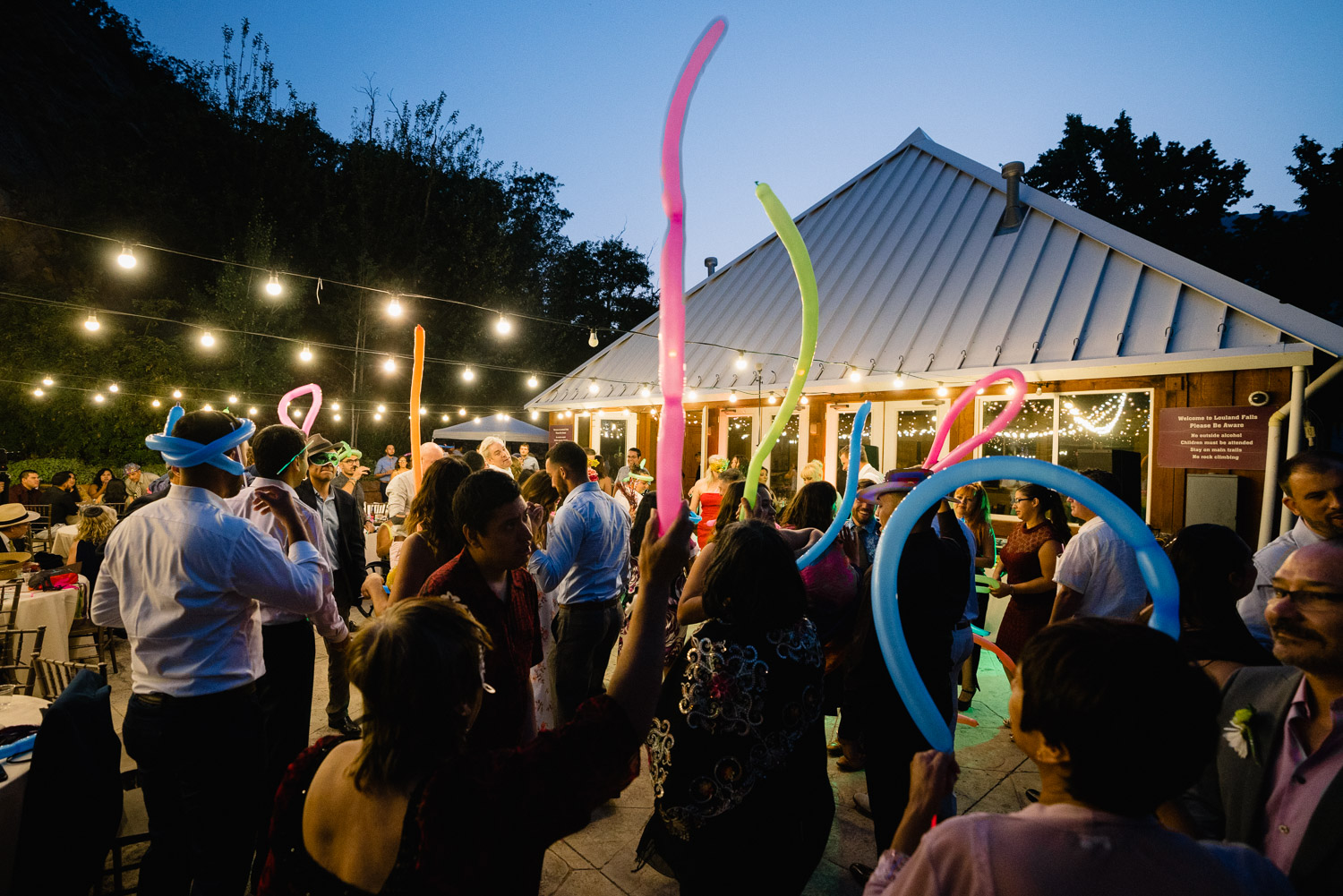 guests celebrating with colorful balloons louland falls wedding