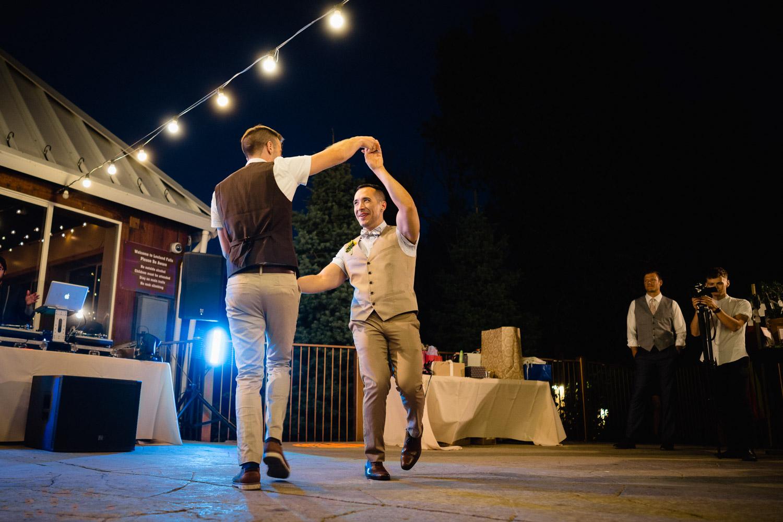 grooms dancing at night under lights louland falls