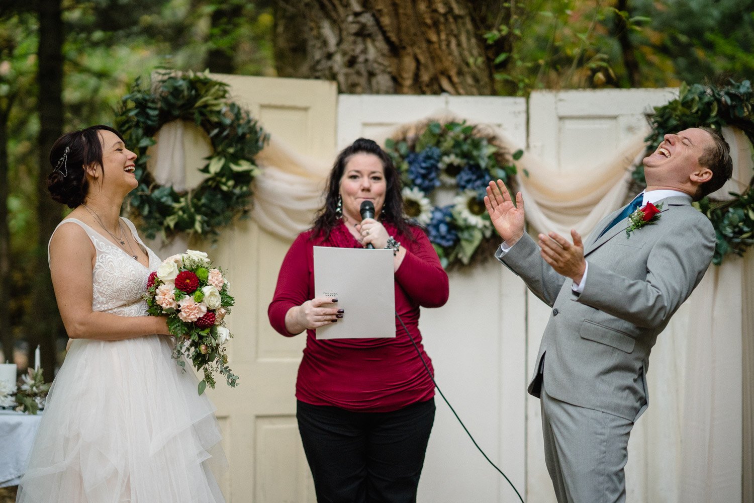 officiant at outdoor altar making bride and groom laugh millcreek canyon wedding