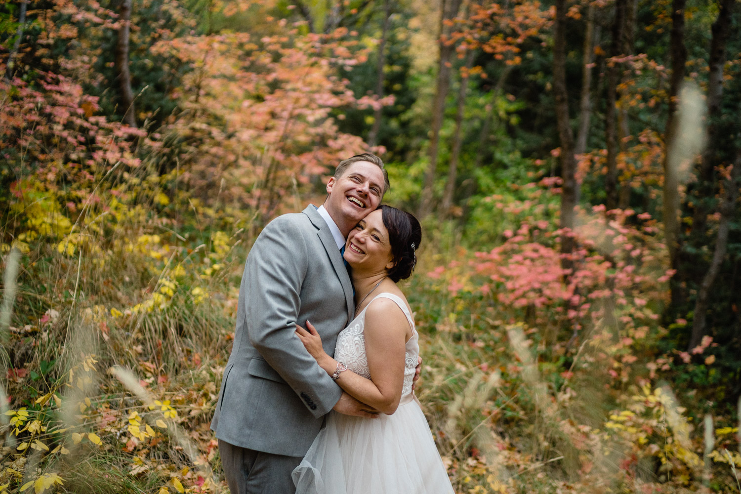 bride and groom smiling outside fall wedding millcreek canyon