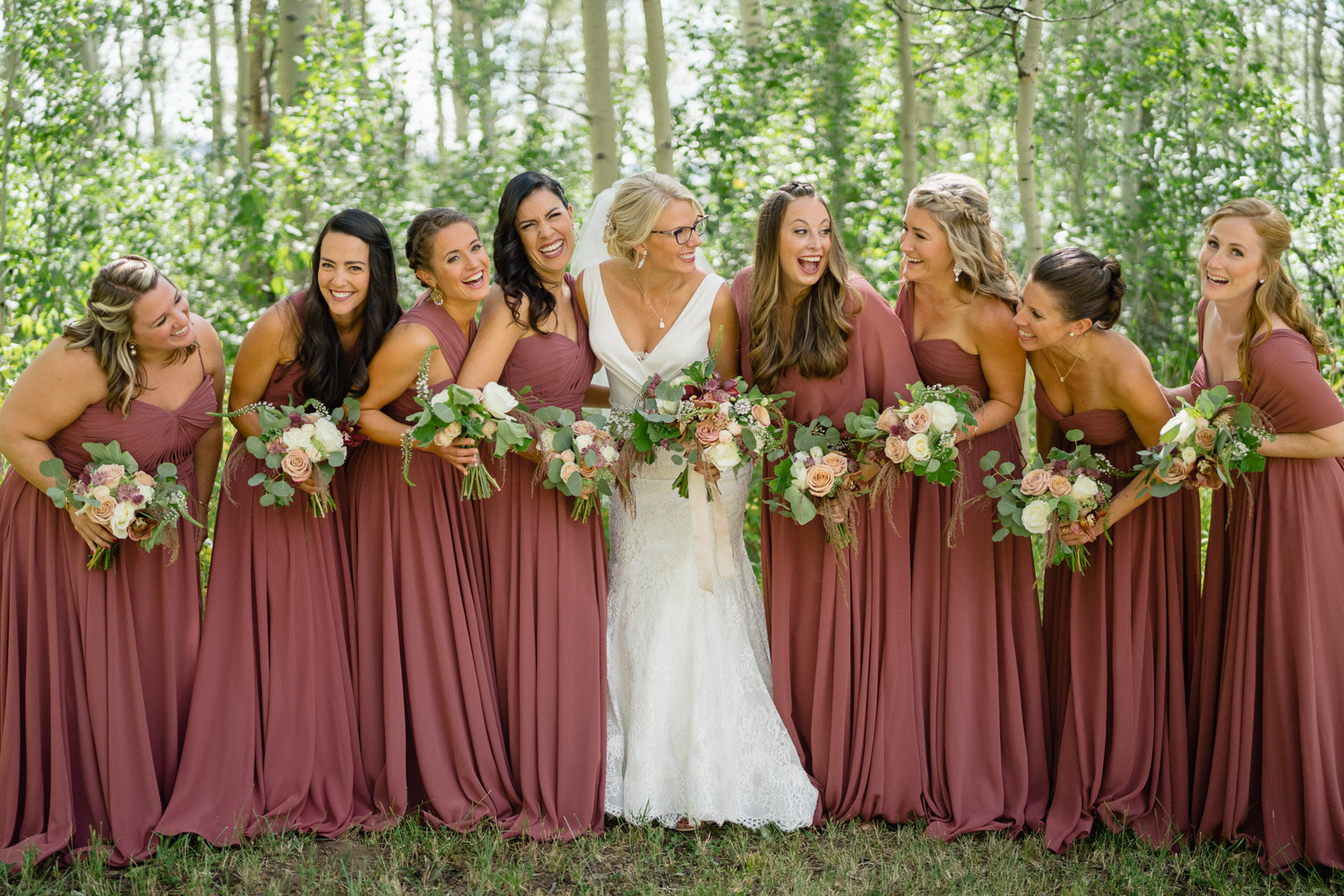 bride and bridal party outside in aspen trees park city utah