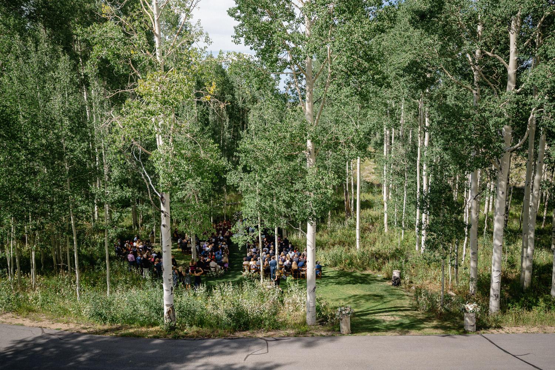wedding party from afar under aspen trees park city utah
