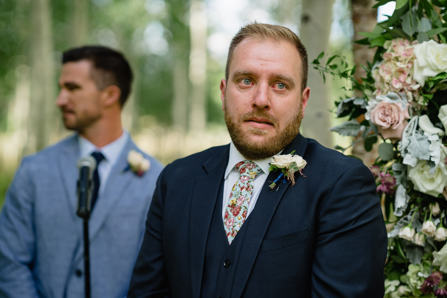 groom with tear filled eyes outdoor park city wedding
