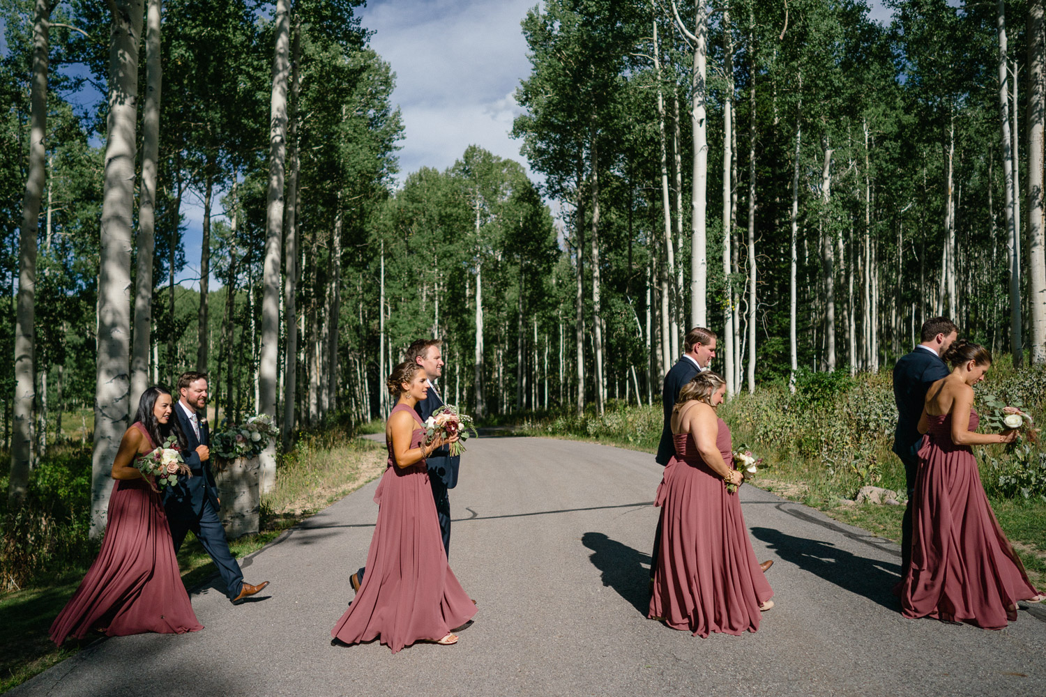 wedding party walking in pairs aspen trees park city