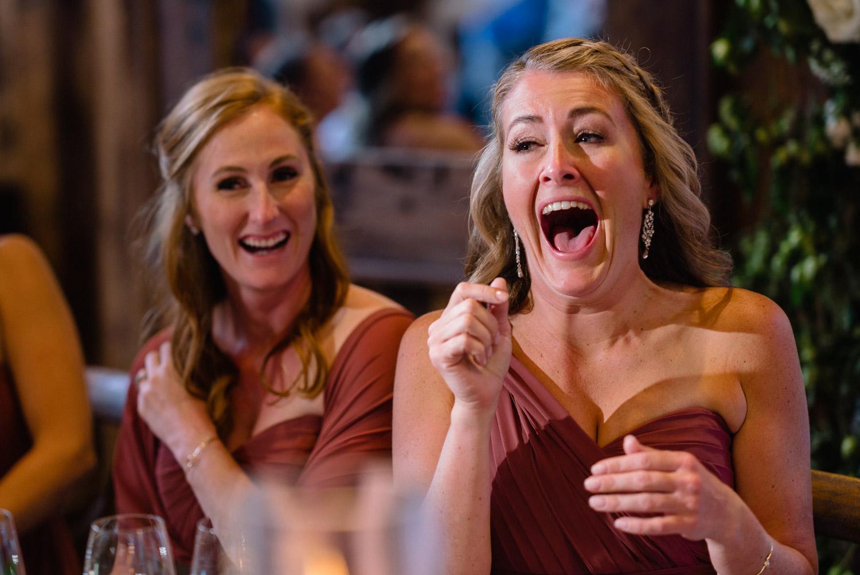 bridesmaid laughing at reception park city