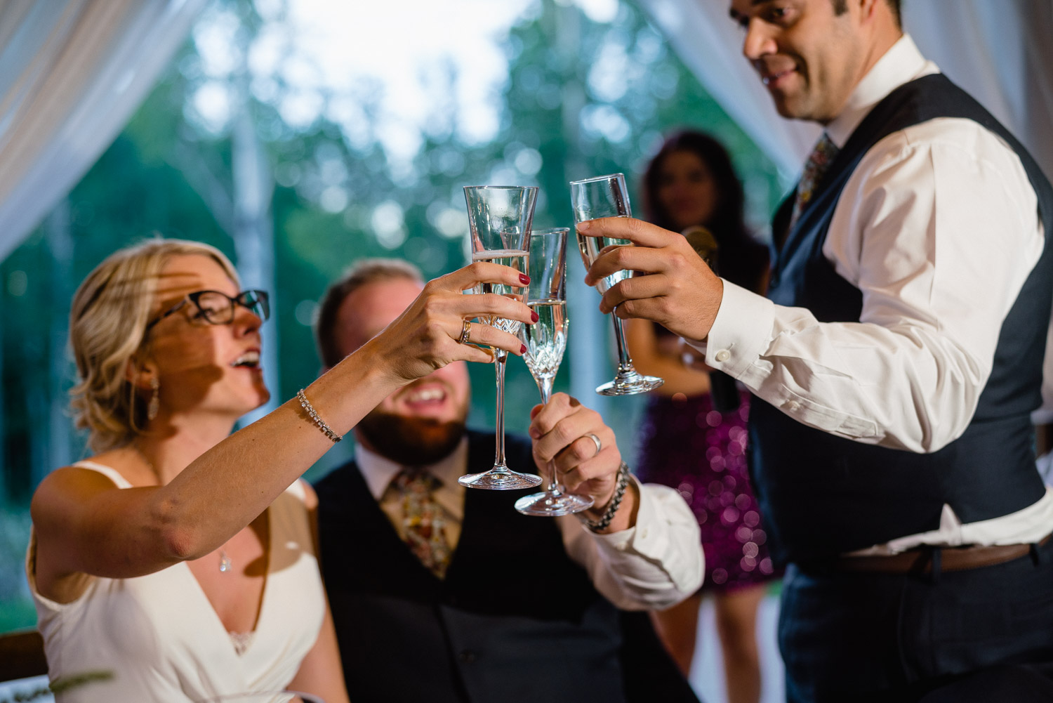 bride and groom cheers man after toast park city reception