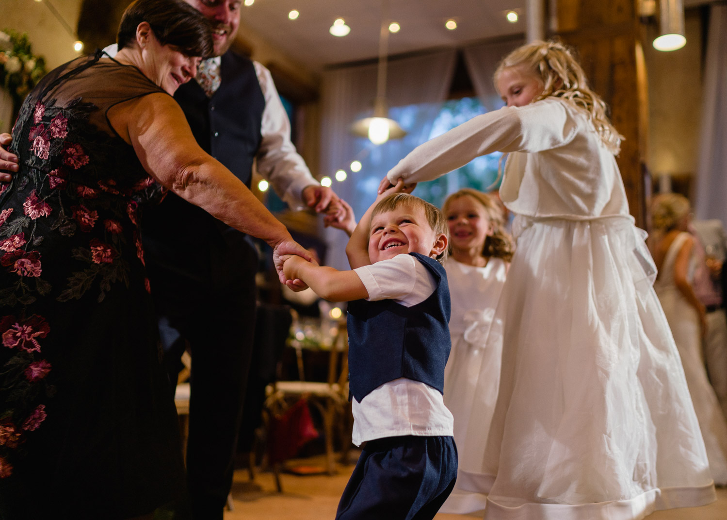 grandparents dance with kids at park city reception