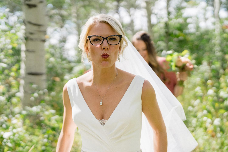 bride making fierce face outside aspen trees park city