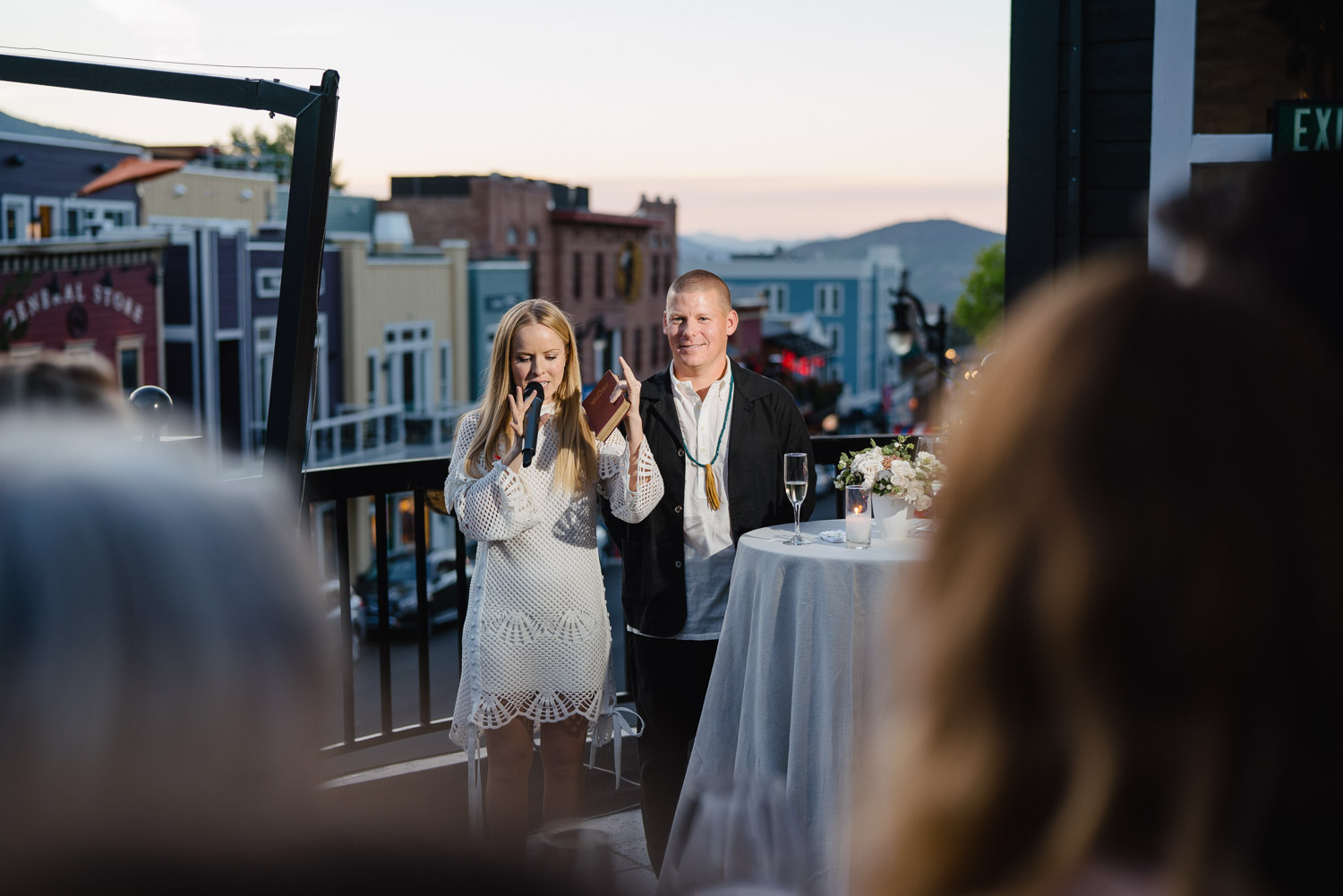 bride and groom talking to guests at rehearsal dinner riverhorse on main park city utah