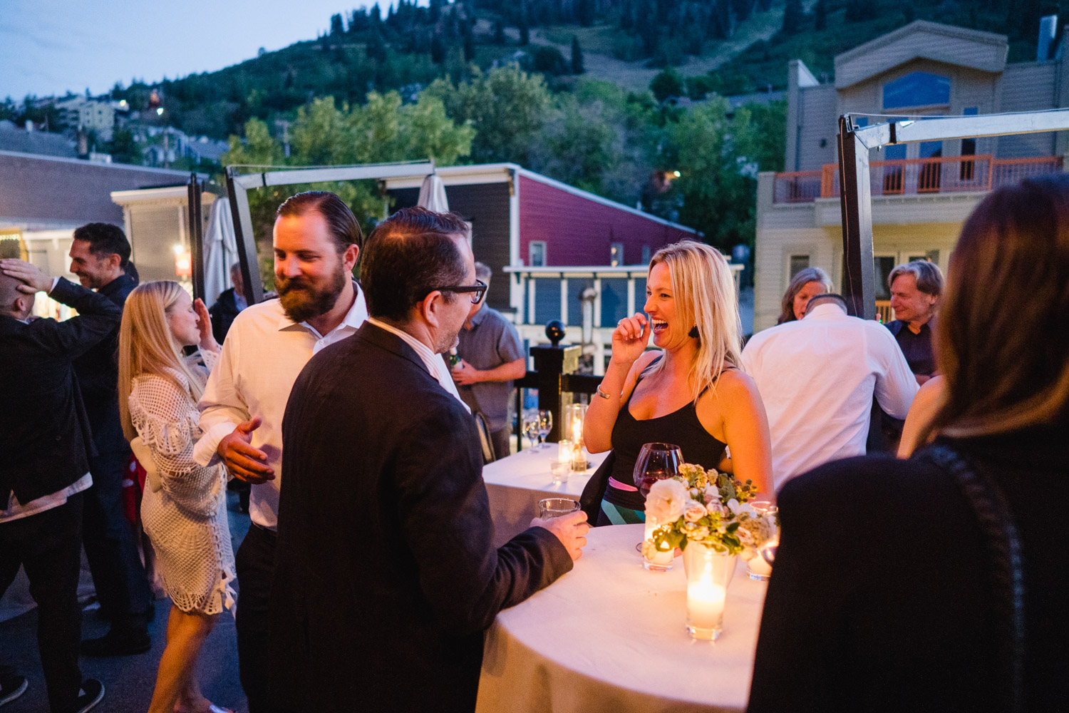 happy guests having drinks on riverhorse deck park city utah