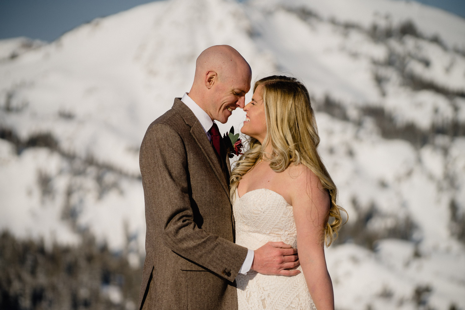 happy couple snowy mountain