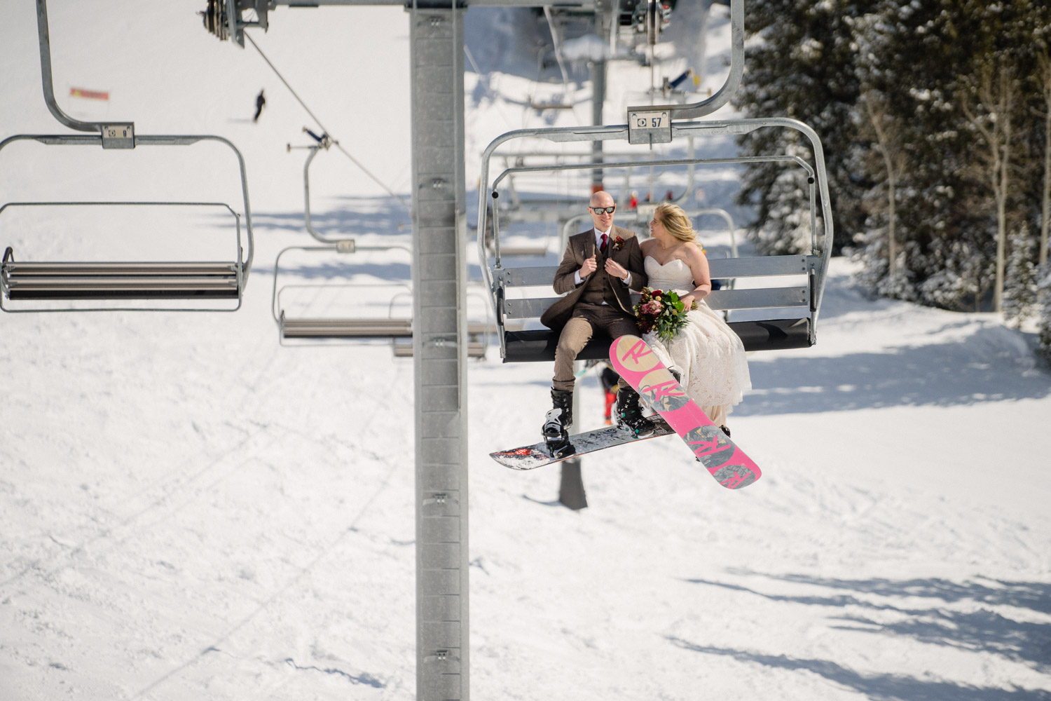bride and groom on chairlift at brighton utah