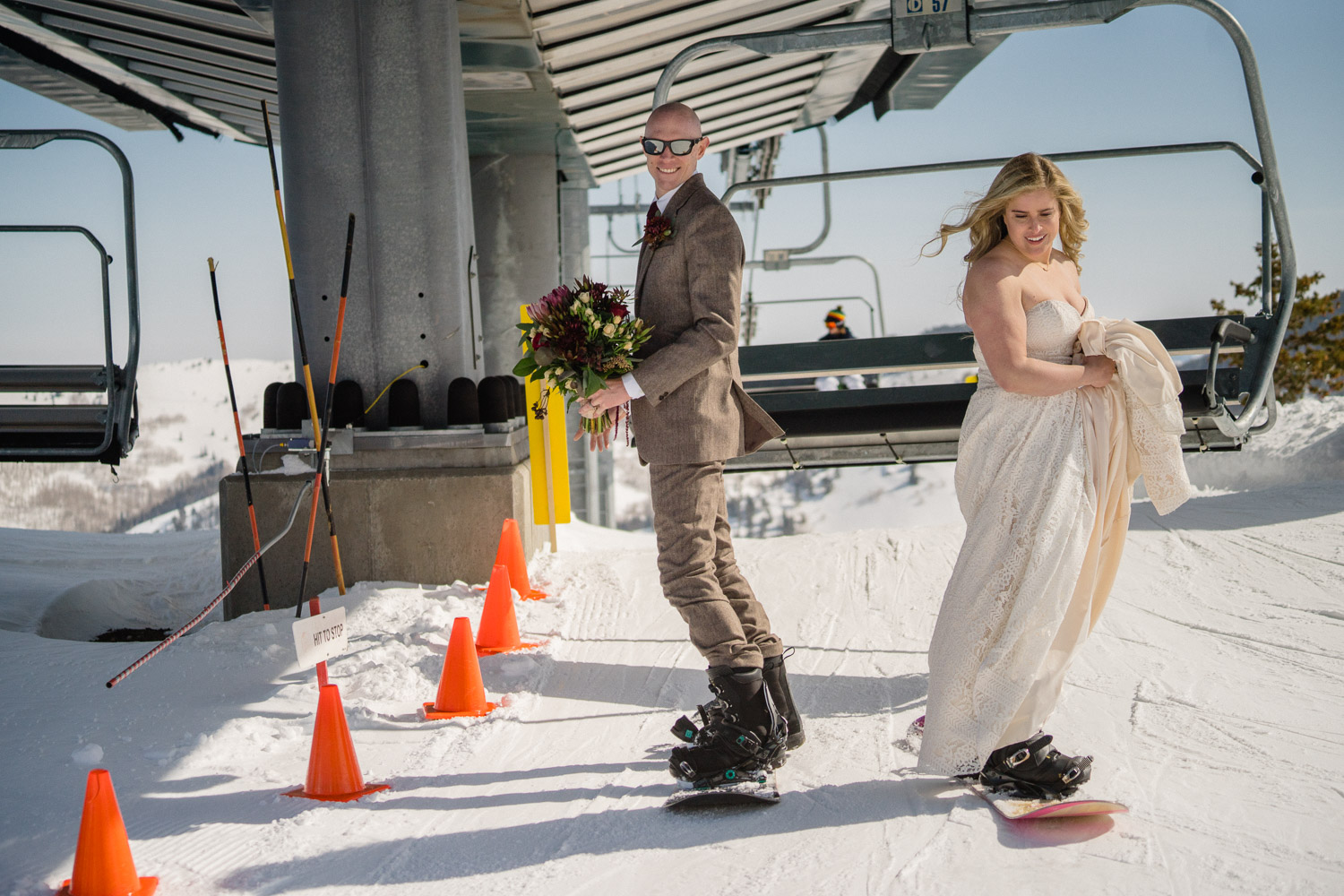 bride and groom in lift line at brighton resort