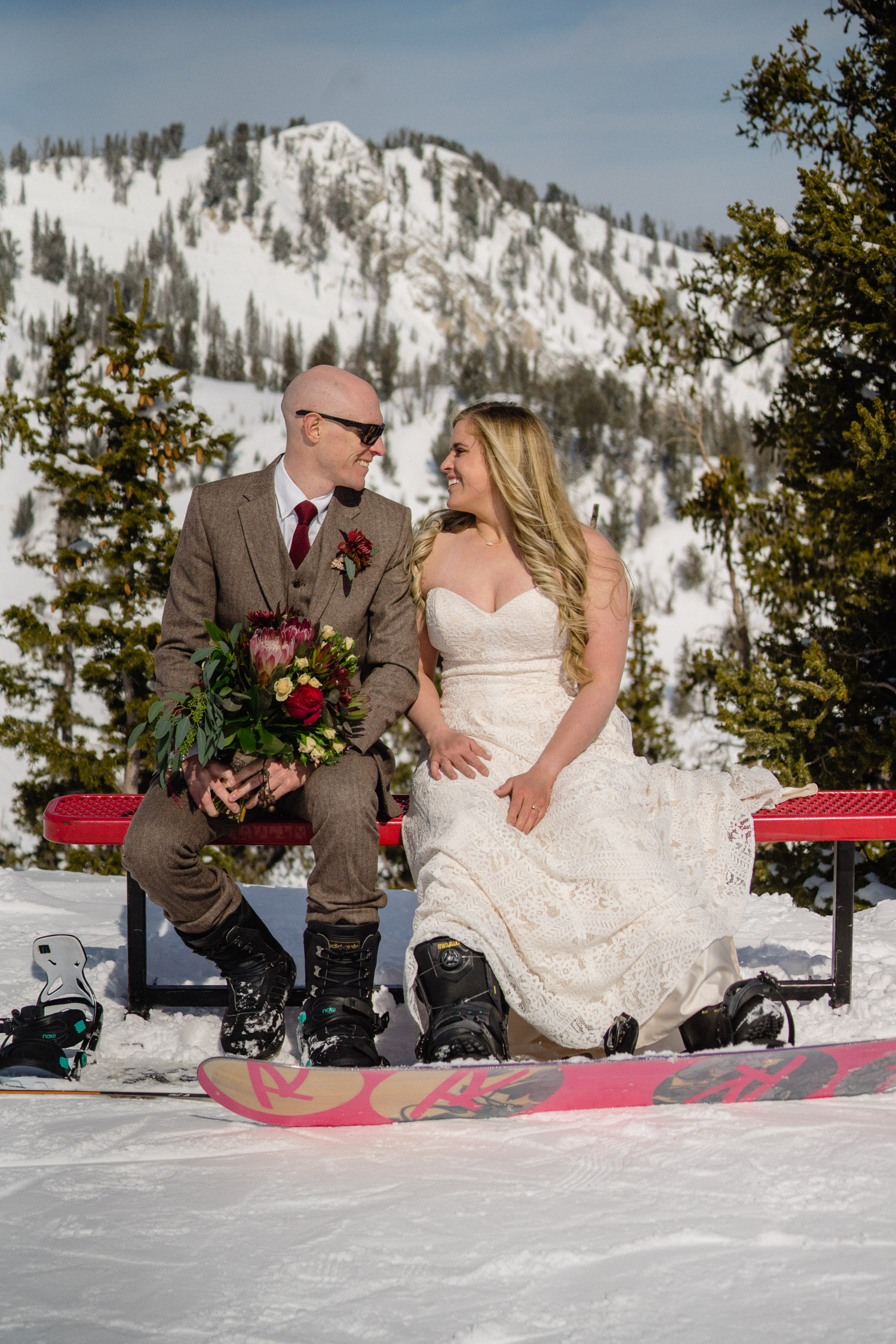 bride and groom sitting on bench at brighton resort