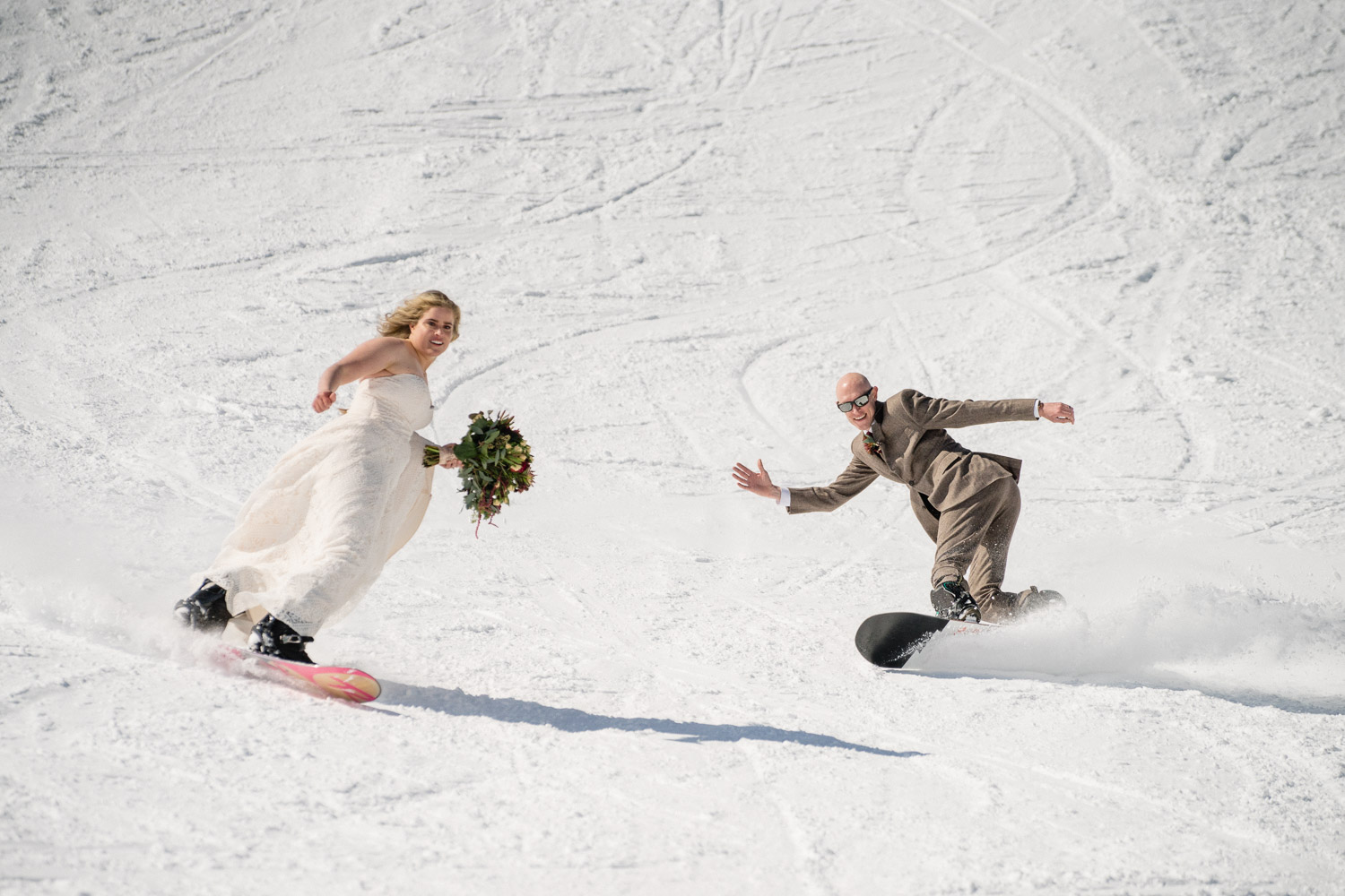 bride and groom snowboarding at brighton resort