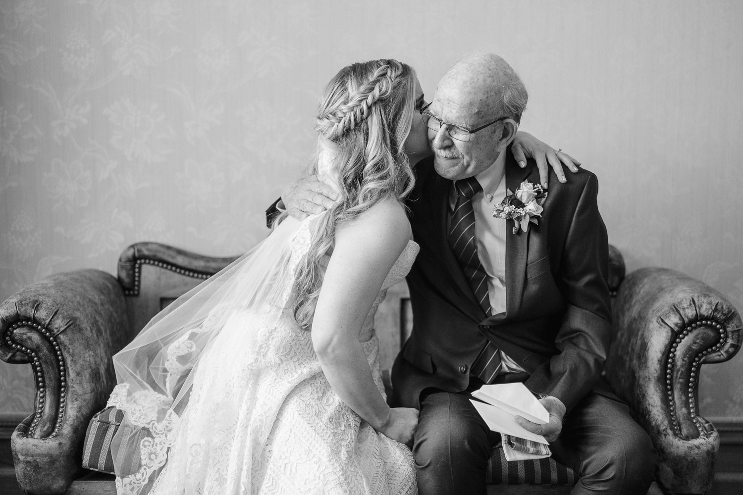 bride and grandpa embracing snowbasin wedding