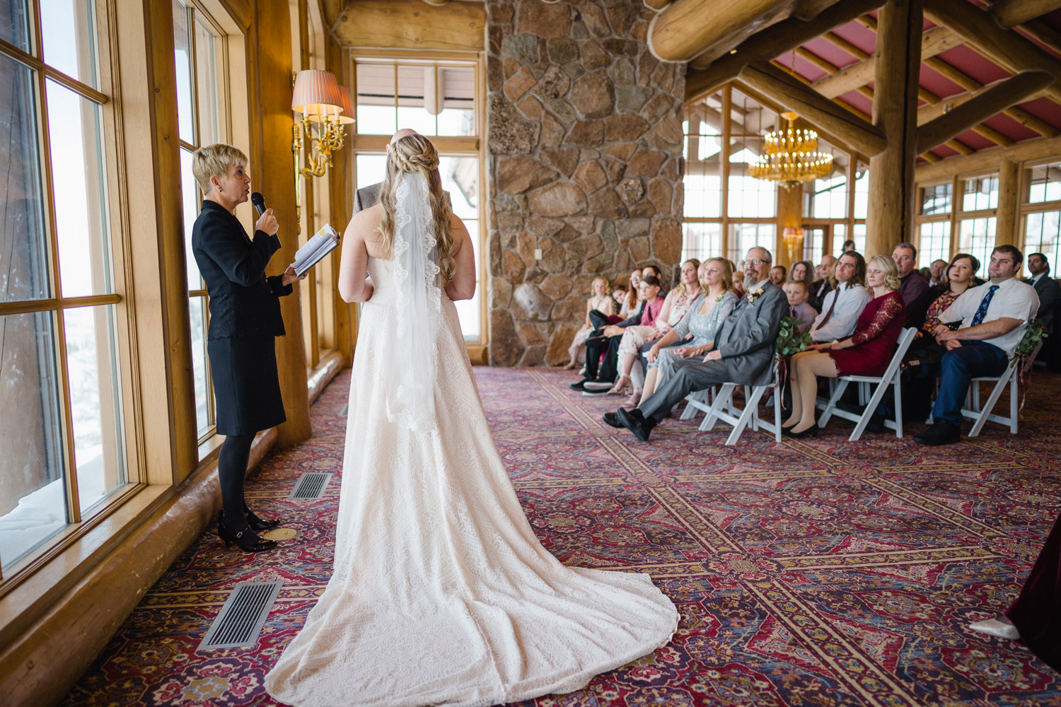 bride train officiant and guests at wedding ceremony snowbasin resort
