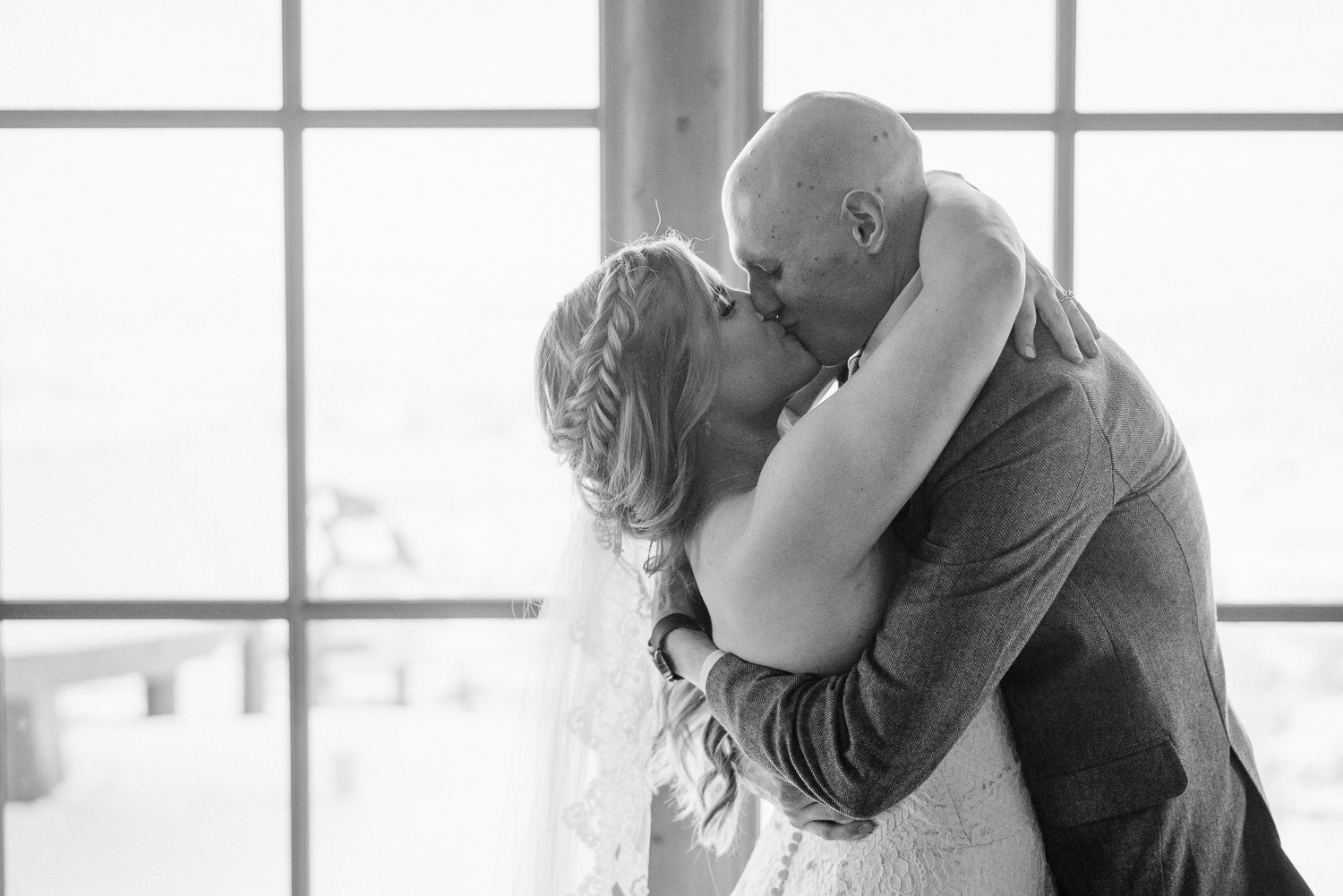 bride and groom embracing and kissing snowbasin resort wedding