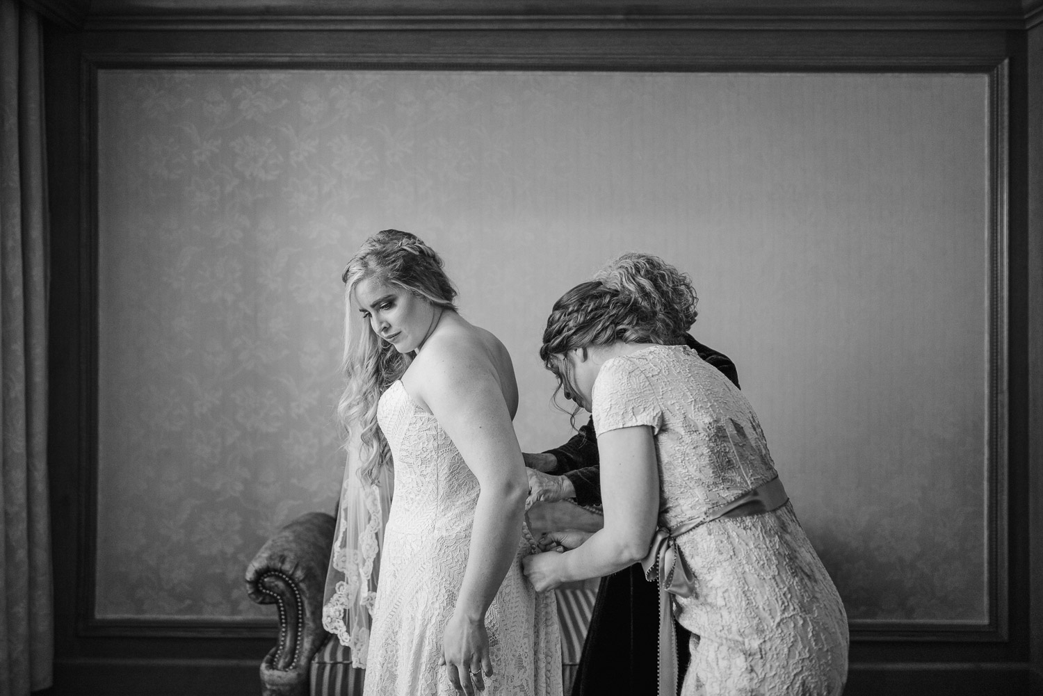 bride getting dressed at Snowbasin Resort
